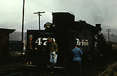 Rear view of switchmen riding the tender of D&amp;RGW #473 while switching the Durango yards.<br /> D&amp;RGW  Durango, CO