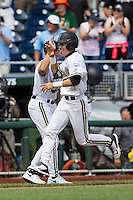 Vanderbilt Commodores outfielder Jeren Kendall (3) celebrates after his walk off 2 run home run during the NCAA College baseball World Series against the Cal State Fullerton Titans on June 15, 2015 at TD Ameritrade Park in Omaha, Nebraska. Vanderbilt beat Cal State Fullerton 4-3. (Andrew Woolley/Four Seam Images)