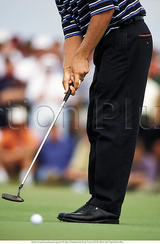 Detail of a golfer putting on a green, The Open Championship, Royal Troon, 970720. Photo: Neil Tingle/Action Plus...1997.club.putt putter.  detail.sports equipment. s.  ident.golfers golf.closeup close up close-up.illustration.leg legs.foot feet.hand hands
