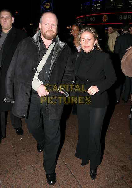 STEVE MCFADDEN & LUCY BENJAMIN.leaving Shoreditch film premiere.27/11/2003.broken arm, wrist, sling, bandage, injury.www.capitalpictures.com.sales@capitalpictures.com.© Capital Pictures.