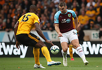 Burnley's Sam Vokes and Wolverhampton Wanderers' Willy Boly<br /> <br /> Photographer Rachel Holborn/CameraSport<br /> <br /> The Premier League - Wolverhampton Wanderers v Burnley - Sunday 16th September 2018 - Molineux - Wolverhampton<br /> <br /> World Copyright &copy; 2018 CameraSport. All rights reserved. 43 Linden Ave. Countesthorpe. Leicester. England. LE8 5PG - Tel: +44 (0) 116 277 4147 - admin@camerasport.com - www.camerasport.com
