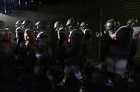 Ohio State football players wait to enter the field prior to the first quarter of the Big Ten championship football game against the Michigan State Spartans at Lucas Oil Stadium in Indianapolis on Dec. 7, 2013. (Adam Cairns / The Columbus Dispatch)
