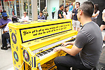 Abby Mueller and the cast of 'Beautiful - The Carole King Musical' unveil a special 'Sing For Hope' Piano with a public Pop-Up performance at One Penn Plaza East  on June 21, 2017 in New York City.