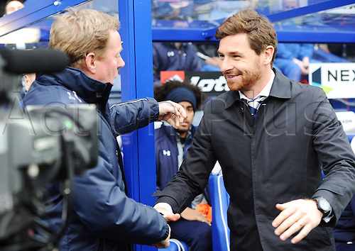 12.01.2013 London, England.  Andre Villas-Boas manager of Tottenham and Harry Redknapp manager of Queens Park Rangers shake hands ahead of the Premier League game between Queens Park Rangers and Tottenham Hotspur from Loftus Road.