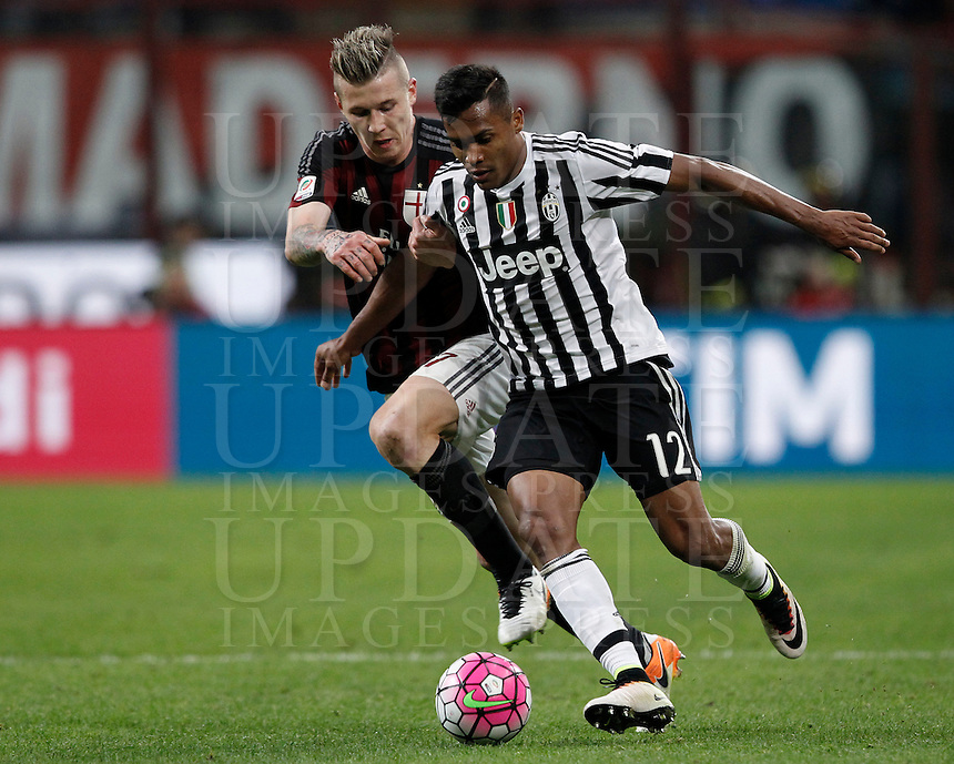 Calcio, Serie A: Milan vs Juventus. Milano, stadio San Siro, 9 aprile 2016. <br /> Juventus&rsquo; Alex Sandro, right, is challenged by AC Milan&rsquo;s Juraj Kucka during the Italian Serie A football match between AC Milan and Juventus at Milan's San Siro stadium, 9 April 2016.<br /> UPDATE IMAGES PRESS/Isabella Bonotto