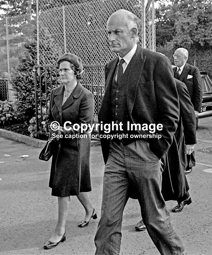 Lord Justice John MacDermott, accompanied by his wife, arrives at St Brigid's Roman Catholic Church, Belfast, for the funeral mass of his colleague, Judge Rory Conaghan,who was murdered by the Provisional IRA. Lord Justice MacDermott, is the son of a previous (now retired) Lord Chief Justice, Lord MacDermott. 197409160494b.<br />