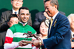 Brazilian jockey Joao Moreira who rode Neorealism receives a trophy after his horse Neorealism won the Audemars Piguet QEII Cup horse race at Sha Tin race course on April 30, 2017 in Hong Kong, China. (Photo by Marcio Rodrigo Machado / Power Sport Images)