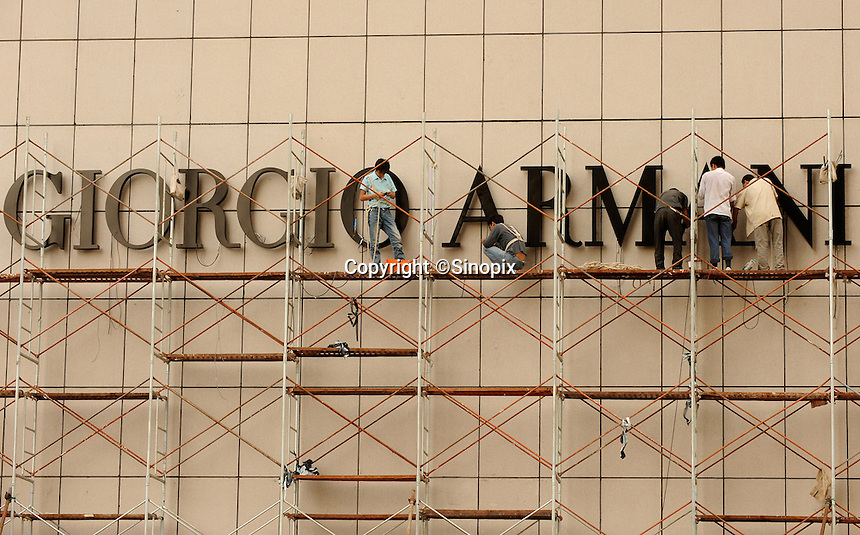 A sign in completed for a Giorgio Armani shop in the center of Beijing that has just been builtin the Central Business District in Beijing..03 Jul 2008