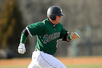 First baseman Zach Krider (24) of the University of South Carolina Upstate Spartans runs out a grounder in a game against the Citadel Bulldogs on Tuesday, February, 18, 2014, at Cleveland S. Harley Park in Spartanburg, South Carolina. Upstate won, 6-2. (Tom Priddy/Four Seam Images)