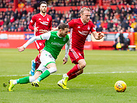 7th March 2020; Pittodrie Stadium, Aberdeen, Scotland; Scottish Premiership Football, Aberdeen versus Hibernian; Tom James of Hibernian and Martin Boyle of Hibernian compete for possession of the ball