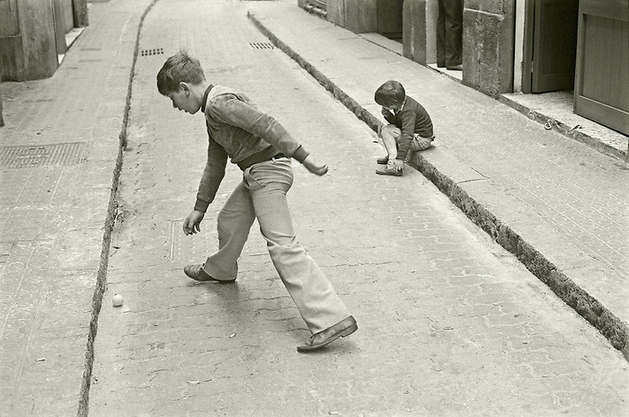 Two boys in a Barcelona back street.<br />