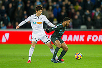 Raheem Sterling of Manchester City protects the ball from Ki Sung-Yueng of Swansea City during the EPL - Premier League match between Swansea City and Manchester City at the Liberty Stadium, Swansea, Wales on 13 December 2017. Photo by Mark  Hawkins / PRiME Media Images.