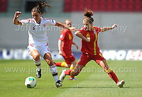 Angharad James of Wales battles with Anna Fisker of Denmark during the UEFA Womens U19 Championships at Parc y Scarlets, Monday 19th August 2013. All images are the copyright of Jeff Thomas Photography-www.jaypics.photoshelter.com-07837 386244-Any use of images must be authorised by the copyright owner.