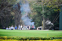 Something is burning behind the 7th green and the gallery doesn't realize it or doesn't care during round 2 of the World Golf Championships, Mexico, Club De Golf Chapultepec, Mexico City, Mexico. 3/3/2017.<br /> Picture: Golffile | Ken Murray<br /> <br /> <br /> All photo usage must carry mandatory copyright credit (&copy; Golffile | Ken Murray)