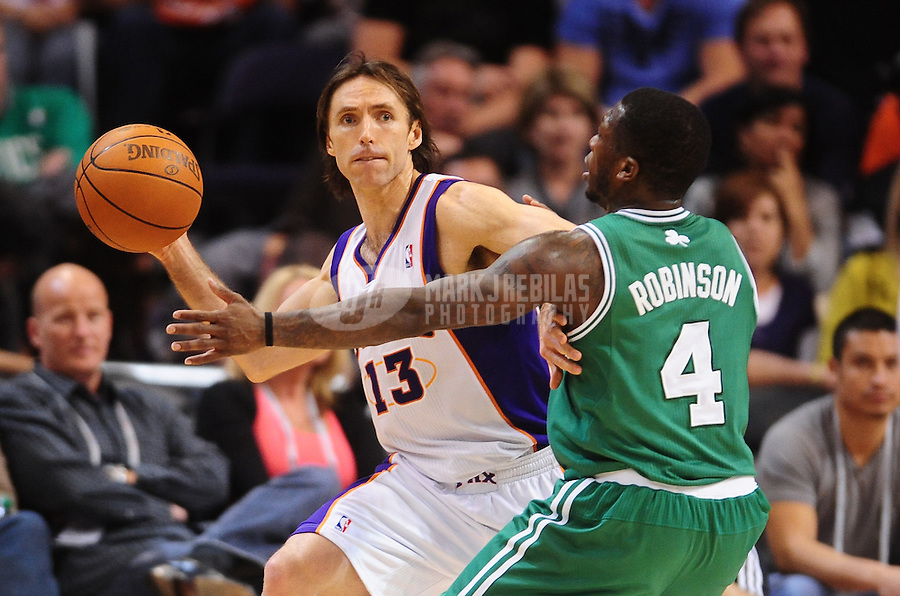 Jan. 28, 2011; Phoenix, AZ, USA; Phoenix Suns guard (13) Steve Nash passes the ball under pressure from Boston Celtics guard (4) Nate Robinson in the first half at the US Airways Center. Mandatory Credit: Mark J. Rebilas-