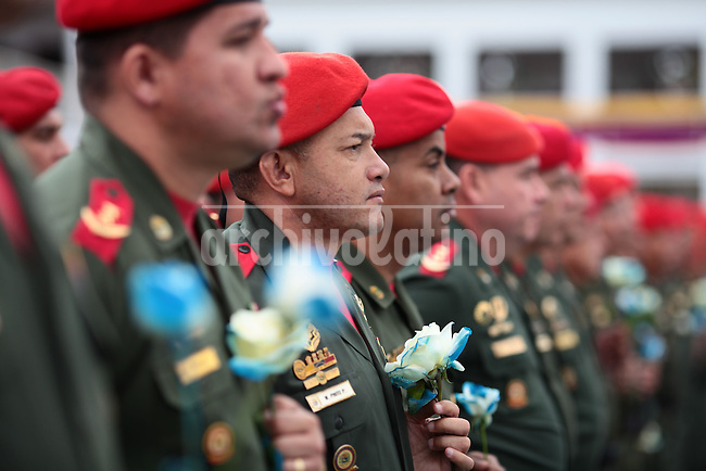 Venezuelan President Nicolas Maduro gives the sword of independence heroe Simon Bolivar to the Presidential Guard in a ceremony in Caracas. Maduro said the Presidential Guard will be the keeper of the historical sword because of their loyalty to Venezuelan leader Hugo Chavez.