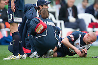 MELBOURNE, AUSTRALIA - SEPTEMBER 12, 2010: Kevin Muscat from the Victory gets attention for his ankle injury in Round 6 of the 2010 A-League between the Melbourne Victory and Brisbane Roar at AAMI Park on September 12, 2010 in Melbourne, Australia. (Photo by Sydney Low / Asterisk Images)