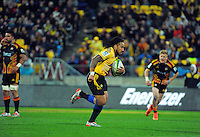 Ma'a Nonu takes an intercept to race away for his second try during the Super Rugby match between the Hurricanes and Chiefs at Westpac Stadium, Wellington, New Zealand on Saturday, 16 May 2015. Photo: Dave Lintott / lintottphoto.co.nz