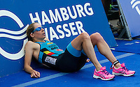 12 JUL 2014 - HAMBURG, GER - Katrien Verstuyft (BEL) from Belgium recovers after finishing the elite women's 2014 ITU World Triathlon Series round in the Altstadt Quarter, Hamburg, Germany (PHOTO COPYRIGHT © 2014 NIGEL FARROW, ALL RIGHTS RESERVED)