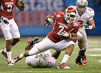 Knile Davis of Arkansas runs the ball against Ohio State during 77th Annual Allstate Sugar Bowl Classic at Louisiana Superdome in New Orleans, Louisiana on January 4th, 2011.  Ohio State defeated Arkansas, 31-26.