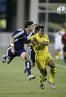 Columbus Crew's Mario Rodriguez, right, and New England Revolution's Jay Heaps head the ball during the first half Wednesday Sept. 21, 2005, in Columbus, Ohio. (ISI Photo/Jay LaPrete)