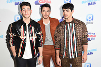 Jonas Brothers<br /> poses on the media line before performing at the Summertime Ball 2019 at Wembley Arena, London<br /> <br /> ©Ash Knotek  D3506  08/06/2019
