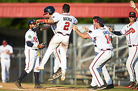 Carlos Baerga Jr. (2) of the Danville Braves celebrates with teammate AJ Graffanino (12) after his walk-off single in the bottom of the tenth inning against the Bristol Pirates at American Legion Post 325 Field on July 1, 2018 in Danville, Virginia. The Braves defeated the Pirates 3-2 in 10 innings. (Brian Westerholt/Four Seam Images)