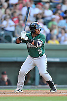 Third baseman Miguel Gomez (9) of the Augusta GreenJackets bats in a game against the Greenville Drive on Friday, June 10, 2016, at Fluor Field at the West End in Greenville, South Carolina. Greenville won, 5-4. (Tom Priddy/Four Seam Images)