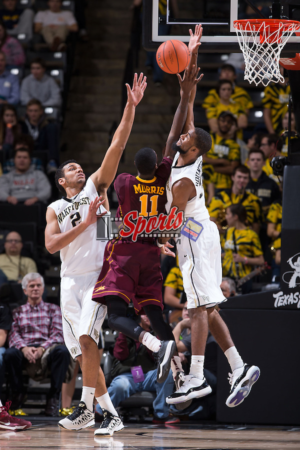 Aaron Rountree III (33) of the Wake Forest Demon Deacons blocks the shot of Carlos Morris (11) of the Minnesota Golden Gophers during second half action at the LJVM Coliseum on December 2, 2014 in Winston-Salem, North Carolina.  The Golden Gophers defeated the Demon Deacons 84-69. (Brian Westerholt/Sports On Film)