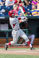 Arkansas Razorbacks second baseman Rick Nomura (1) follows through on his swing during the NCAA College baseball World Series against the Miami Hurricanes on June 15, 2015 at TD Ameritrade Park in Omaha, Nebraska. Miami beat Arkansas 4-3. (Andrew Woolley/Four Seam Images)