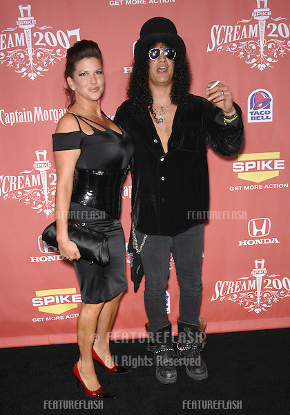 """Slash & wife Perla Ferrer at Spike TV's """"Scream 2007"""" Awards honoring the best in horror, sci-fi, fantasy & comic genres, at the Greak Theatre, Hollywood..October 20, 2007  Los Angeles, CA.Picture: Paul Smith / Featureflash"""
