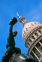 State Capitol building and statue honoring Texas cowboys. Austin Texas.