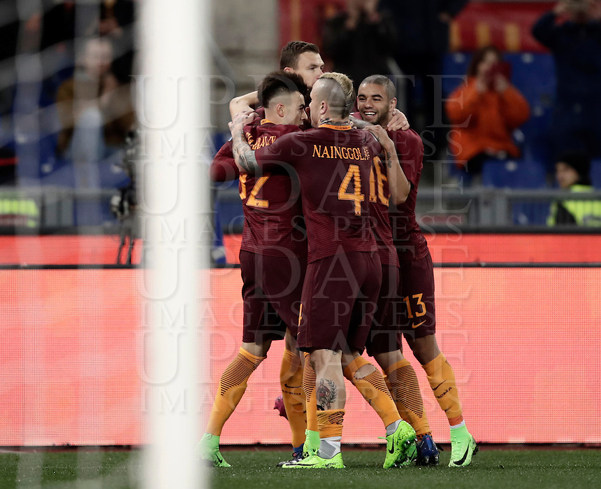 Calcio, Serie A: Roma, Stadio Olimpico, 7 febbraio 2017.<br /> Roma's Edin Dzeko (second from left) celebrates with teammates Stephan El Shaarawy (l) Radja Nainggolan (c) Bruno Peres (r) during the Italian Serie A football match between AS Roma and Fiorentina at Roma's Olympic Stadium, on February 7, 2017.<br /> UPDATE IMAGES PRESS/Isabella Bonotto
