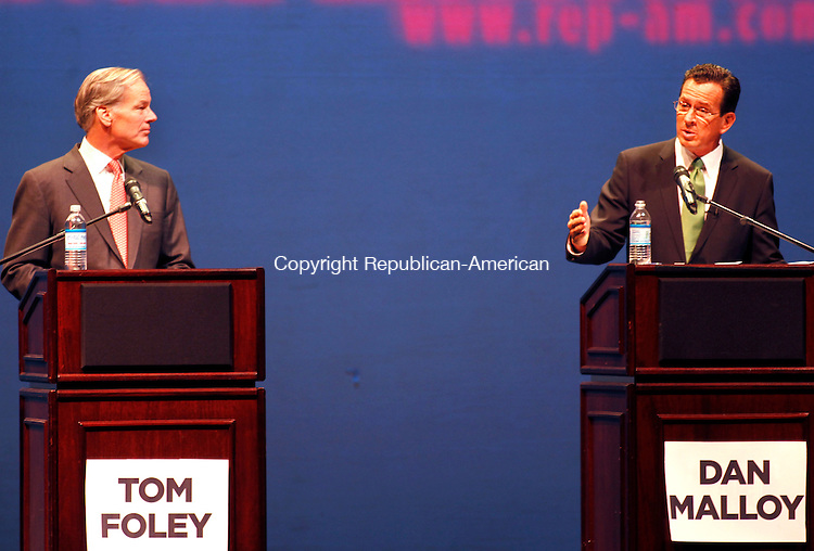 Torrington, CT- 25, October 2010-102510CM11 Republican Governor candidate Tom Foley (left) and Democratic candidate, Dan Malloy  face off during a gubernatorial debate inside the Warner Theater in downtown Torrington Monday night.  The event was moderated by Republican-American Executive Editor, Jonathan Kellogg and was sponsored by the Republican-American newspaper.   Christopher Massa Republican-American