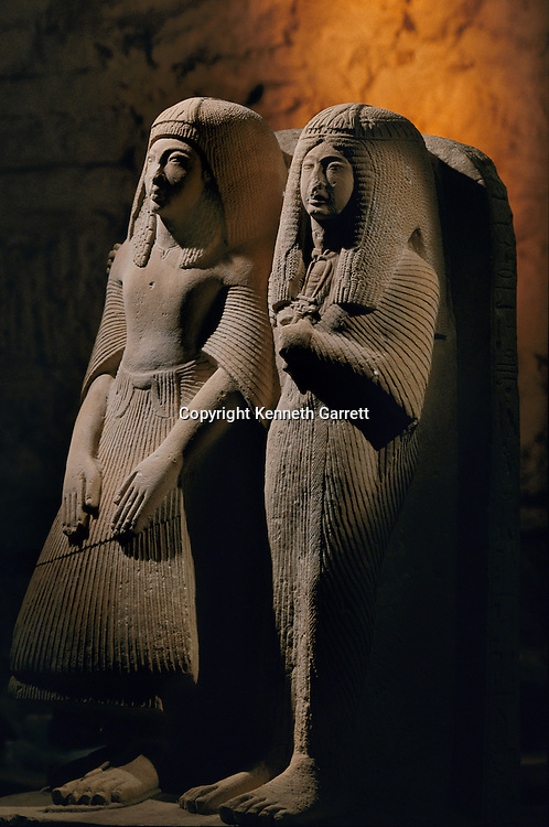 Limestone double statue of a priest named Amenemipet and his wife, New Kingdom