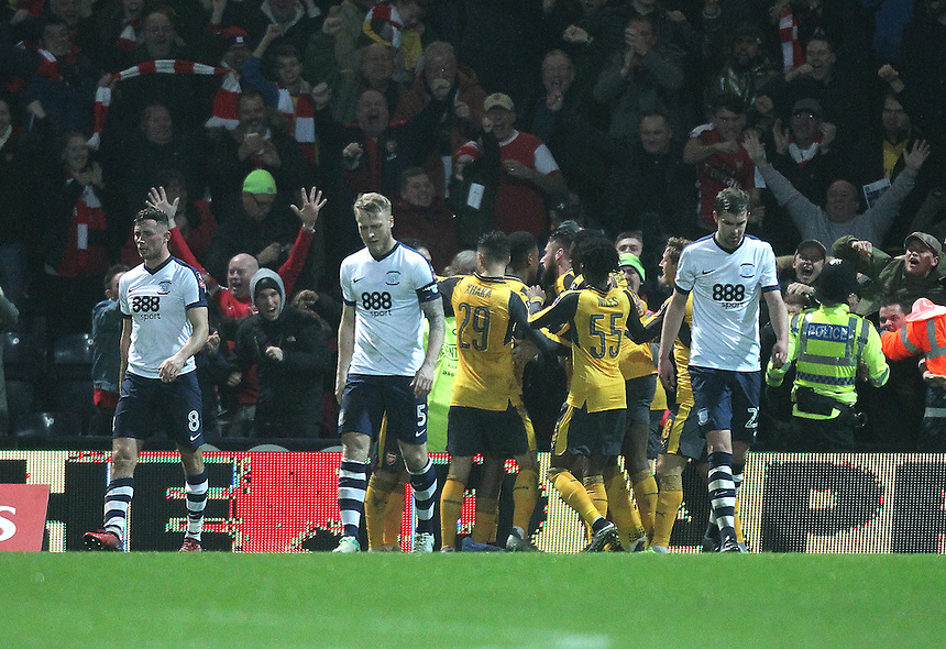Preston North End's look dejected as Arsenal's Olivier Giroud celebrates scoring his sides second goal <br /> <br /> Photographer Mick Walker/CameraSport<br /> <br /> Emirates FA Cup Third Round - Preston North End v Arsenal - Saturday 7th January 2017 - Deepdale - Preston<br />  <br /> World Copyright &copy; 2017 CameraSport. All rights reserved. 43 Linden Ave. Countesthorpe. Leicester. England. LE8 5PG - Tel: +44 (0) 116 277 4147 - admin@camerasport.com - www.camerasport.com