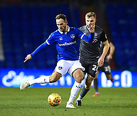 Oldham Athletic's Dan Gardner twists his knee under pressure from Lincoln City's Harry Anderson<br /> <br /> Photographer Andrew Vaughan/CameraSport<br /> <br /> The EFL Sky Bet League Two - Oldham Athletic v Lincoln City - Tuesday 27th November 2018 - Boundary Park - Oldham<br /> <br /> World Copyright © 2018 CameraSport. All rights reserved. 43 Linden Ave. Countesthorpe. Leicester. England. LE8 5PG - Tel: +44 (0) 116 277 4147 - admin@camerasport.com - www.camerasport.com