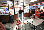 "Newell co-hosts a radio show called ""Coach's Corner"" once a week. The show is for Mountain Elementary School and broadcasts out of the town's Hardee's. Twenty percent of the sales benefit the athletic group featured for the week. ""We get a good crowd out here,"" said Newell. Photo by Tessa Lighty"