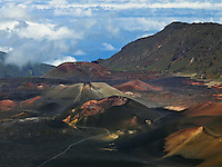 A seemingly endless line of multi colored cinder cones in the crater of HALEAKALA NATIONAL PARK on Maui in Hawaii seem to stretch to the very end