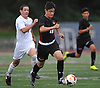 Ethan Koval #18 of Half Hollow Hills East looks to stay ahead of Thomas Jose Garcia #5 of Whitman during the first half of a Suffolk County League II varsity boys soccer game at Whitman High School on Monday, Sept. 19, 2016. Koval scored a goal in the fourth minute of play. Hills East won by a score of 2-1.