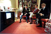 United States President Ronald Reagan, left, is joined by U.S. Vice President George H.W. Bush, center, and U.S. Senator Paul Laxalt (Republican of Nevada) as he watches the election coverage on Tuesday, November 2, 1982 in the Residence of the White House in Washington, D.C..Mandatory Credit: Michael Evans - White House via CNP