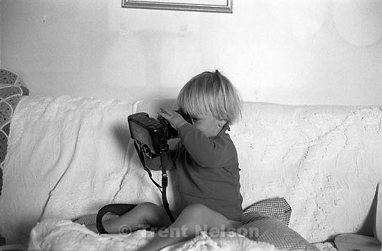 Noah Nelson on couch with a camera.<br />
