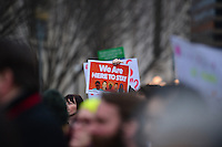 Washington, DC - February 11, 2017: A person holds a sign as hundreds of people gather near the White House in Washington February 11, 2017 for a protest, organized by United We Stand, against the latest immigration raids and deportations by U.S. Immigration and Customs Enforcement agents.  (Photo by Don Baxter/Media Images International)