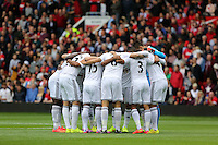 Pictured: Swansea players huddle before kick off. Saturday 16 August 2014<br /> Re: Premier League Manchester United v Swansea City FC at the Old Trafford, Manchester, UK.