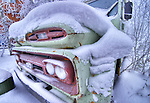 Old snow covered school bus in Yellowknife.