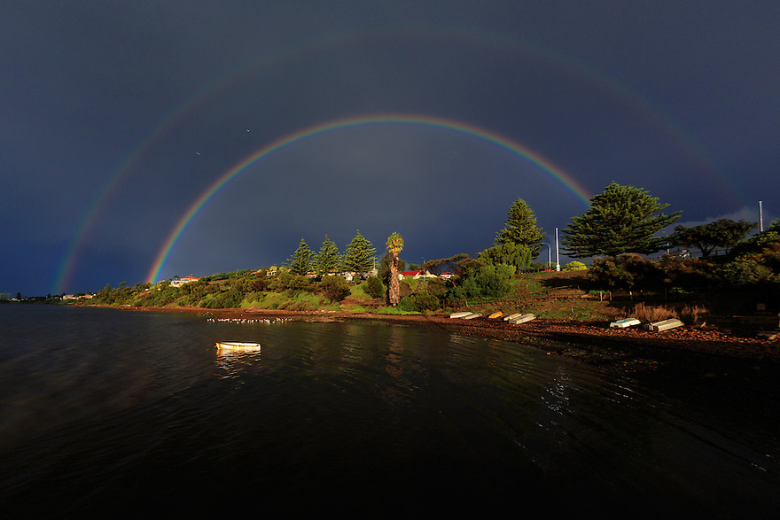 Double rainbow over boats