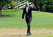 United States President Barack Obama waves to the press pool as he arrives back at the White House in Washington, DC following a short trip to New Brunswick, New Jersey to deliver a commencement speech at Rutgers University on May 15, 2016.<br /> Credit: Dennis Brack / Pool via CNP