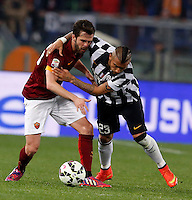 Calcio, Serie A: Roma vs Juventus. Roma, stadio Olimpico, 2 marzo 2015.<br /> Roma's Miralem Pjanic, left, is fouled by Juventus' Arturo Vidal during the Italian Serie A football match between AS Roma and Juventus at Rome's Olympic stadium, 2 March 2015.<br /> UPDATE IMAGES PRESS/Riccardo De Luca