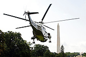 Washington, D.C. - August 1, 2009 -- Marine 1, carrying United States President Barack Obama and his family departs the South Lawn of the White House en route to Camp David on Saturday, August 1, 2009..Credit: Ron Sachs / Pool via CNP