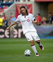 Toronto defender Torsten Frings (22) dribbles the ball.  The Chicago Fire defeated Toronto FC 2-0 at Toyota Park in Bridgeview, IL on August 21, 2011.